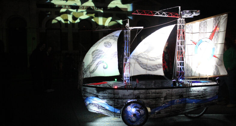 Shipshape projecting dolphins from its onboard projector.