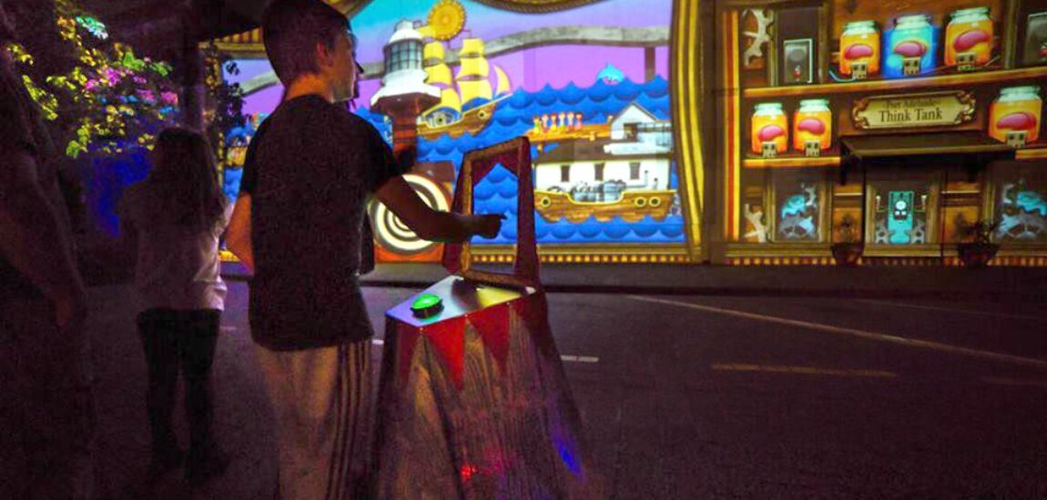 """A boy using the LEAP motion and Big Glowing Button to choose and trigger possible alternative Port Adelaide futures from the """"Think Tank"""" at illuminart's FUTURE PORTAL. Photo by Craig Laurendet."""