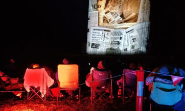 Iconic photo of audience watching Booleroo Silo with projection