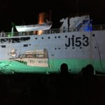 HMAS Whyalla with projection of a corvette illustrated by children
