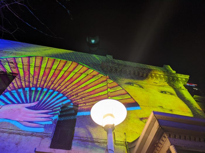 An image of Gladys Sym Choon projected onto Union Street